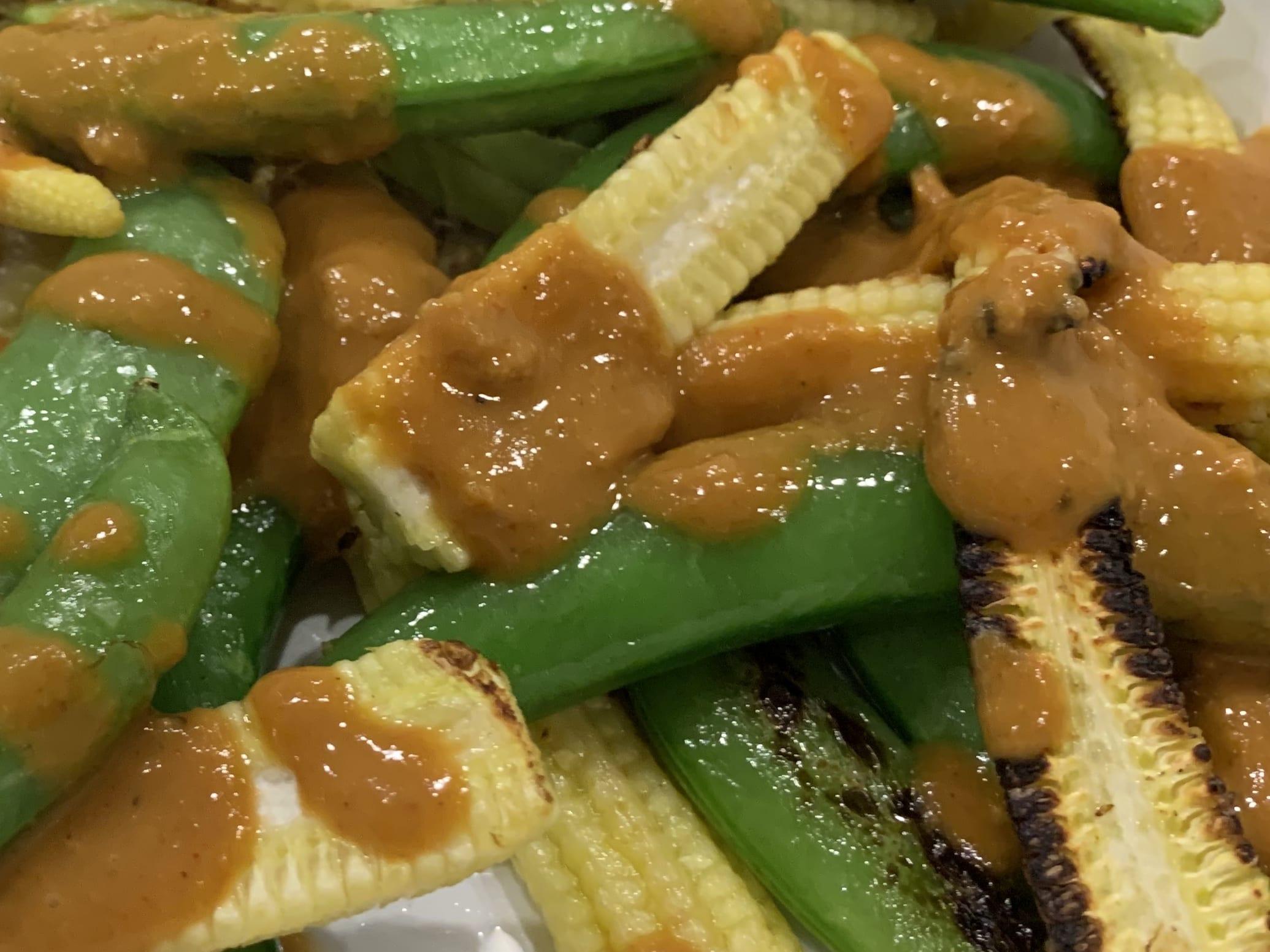 Charred baby sweet corn with peanut sauce