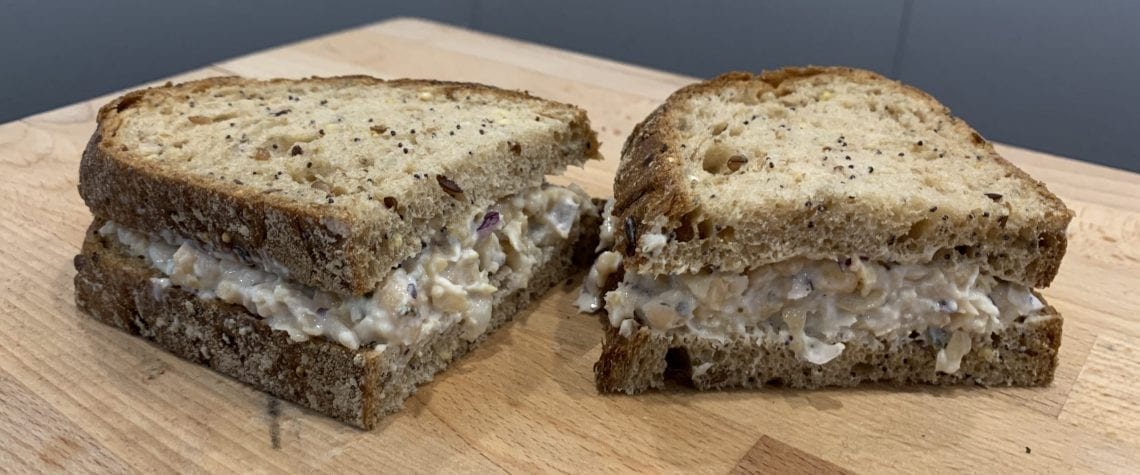 Crushed chickpea and red onion mayo sandwich