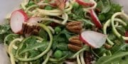 Courgette, pea, radish and pecan rocket salad with lemon dressing