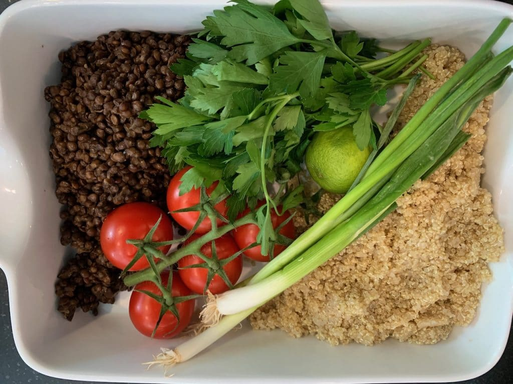 Lentil and quinoa salad with tomatoes and a mint and parsley dressing