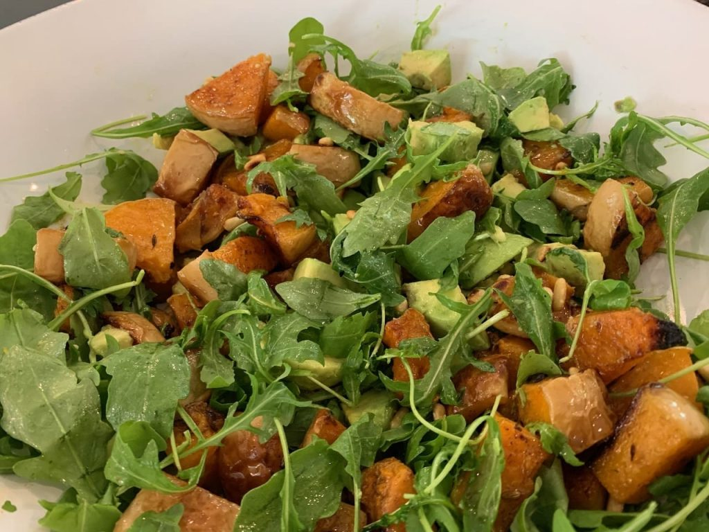 Roasted butternut squash and avocado salad with a raspberry and lemon dressing