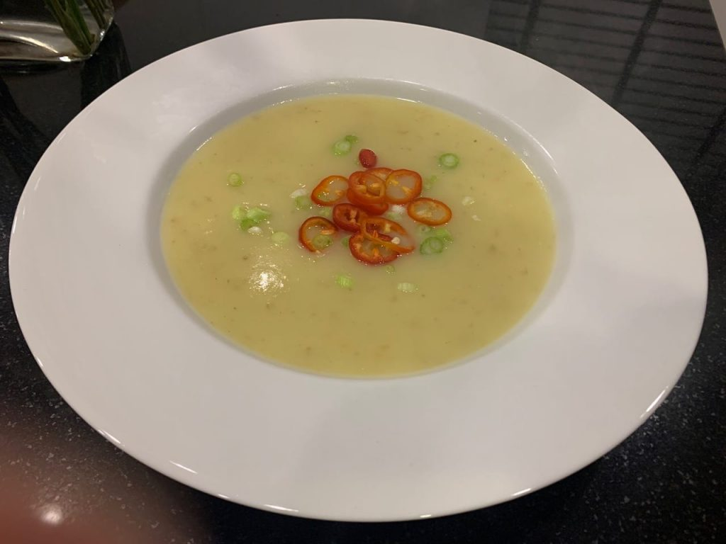 Leek and Potato Soup with spring onion and chilli garnish